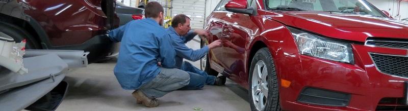 two men working on car repair