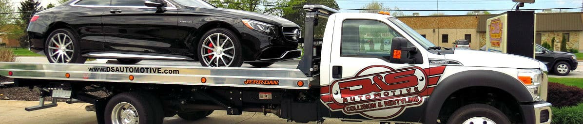D&S flatbed with black Mercedes on it