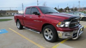 Maroon Dodge Ram side view