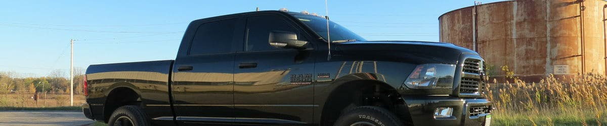 Black Dodge Ram truck with tinted windows